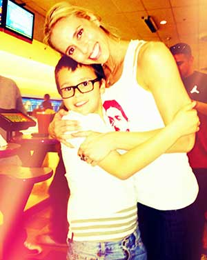 Brenna Ballestero bowling with her son
